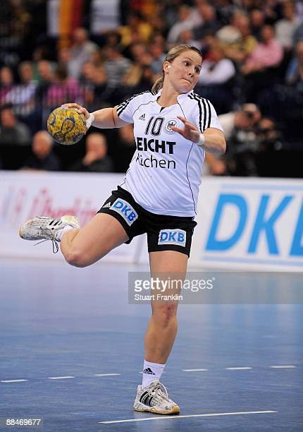 Anna Loerper of Germany throws a goal during the Women's Handball World Championship qualification game between Germany and Serbia at the Color line...