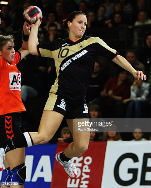 Anna Loerper of Germany throws the ball during the handball match between Germany and the Netherlands on November 26 2007 in Lubbecke Germany