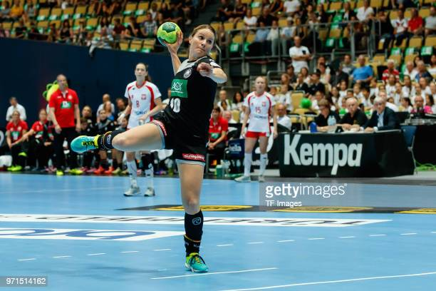 Anna Loerper of Germany throws the ball during the Women's handball International friendly match between Germany and Poland at Olympiahalle on June 6...