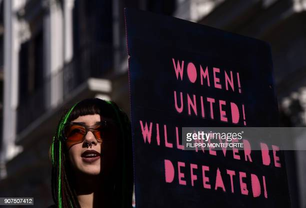 Anna Lou Castoldi daughter of Italian actress Asia Argento holds a banner reading 'Womwn united will never be defeated' during Rome Resists...