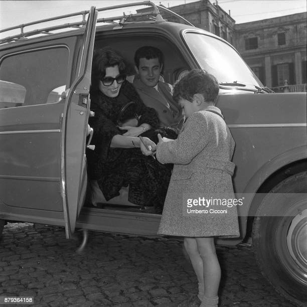 Anna Magnani with her son Luca Magnani they are going to the Casina delle Rose for the Italian film award Nastro D'Argento Rome 1953