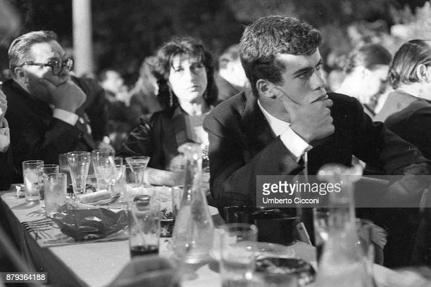 Anna Magnani with his son Luca and Aldo Fabrizi during the Italian film award Nastro D'Argento 1953