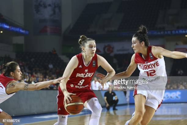 Anna Makurat of Poland in action against Pelin Bilgic and Tugce Canitez of Turkey during the 2019 Women FIBA EuroBasket Qualification Group B match...