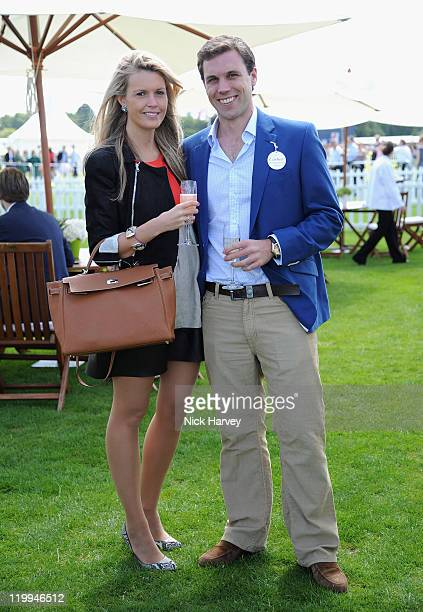 Anna Margaret Smedvig and Sebastian Sain Ley Berry Gray attends the Cartier International Polo Day 2011 at Guards Polo Club Windsor Great Park on...