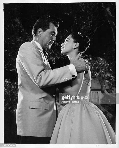Anna Maria Alberghetti being held by unidentified man in a scene from the film 'Cinderfella' 1960
