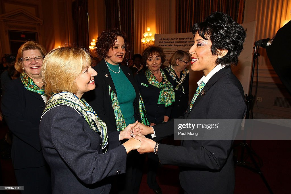 Anna Maria Chavez, Chief Executive Officer of Girl Scouts of the USA, right, greets a guest at Girl Scouts At 100: The Launch of ToGetHerThere at Capitol Hill Cannon House Office Bldg, Caucus Room on February 1, 2012 in Washington, DC.