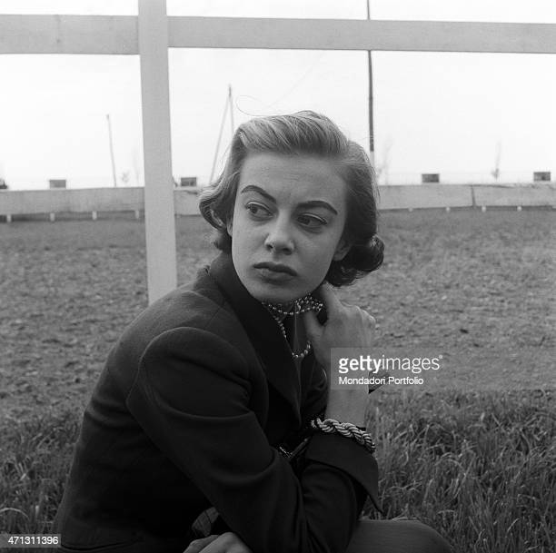 Anna Maria Ferrero the artistic name of Anna Maria Guerra the famous Italian film and television actress poses next to a fence gazing into the...
