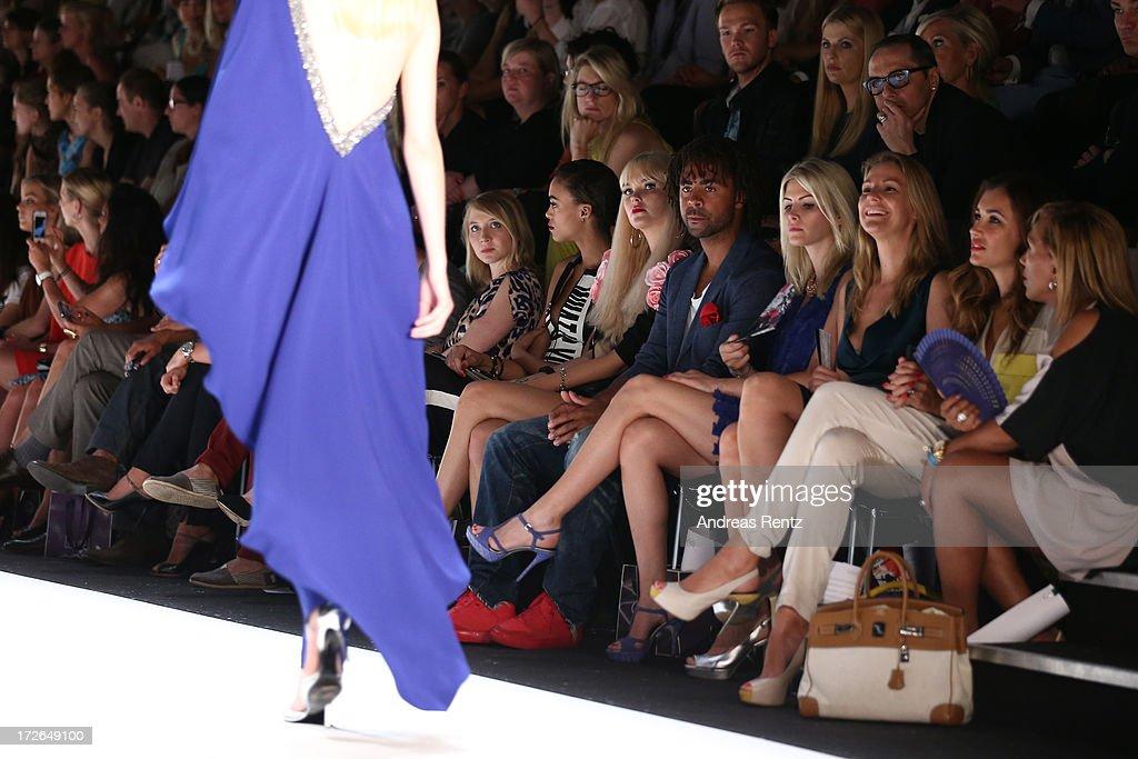 Anna Maria Muehe, Devyn Abdullah, Bonnie Strange, Patrick Owomoyela, Josipa, Sophie Schuett and Jana Ina Zarrella attend the Laurel Show during the Mercedes-Benz Fashion Week Spring/Summer 2014 at Brandenburg Gate on July 4, 2013 in Berlin, Germany.