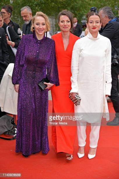 Anna Maria Muehe Julia Hartmann and Nina Gummich arrive at the German Film Award 2019 at Palais am Funkturm on May 3 2019 in Berlin Germany