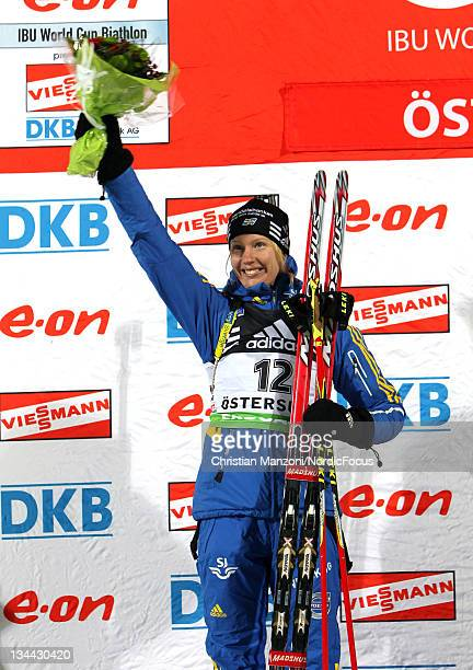 Anna Maria Nilsson celebrates after the womens 15km individual during the IBU Biathlon World Cup on December 01, 2011 in Oestersund, Sweden.