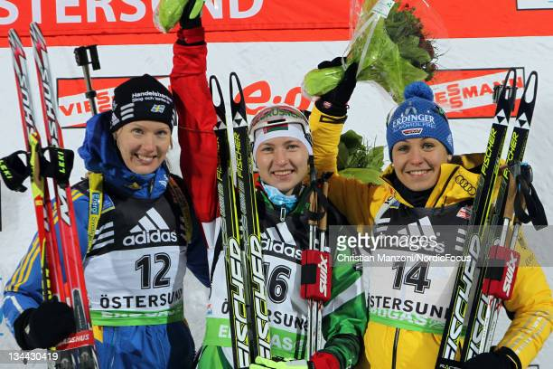 Anna Maria Nilsson of Sweden celebrates with racewinner Darya Domratcheva of Belarus and Magdalena Neuner of Germany after the womens 15km individual...