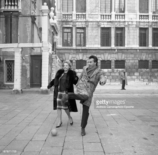 Anna Maria Proclemer plays football with Giorgio Albertazzi in 1961 in Venice Italy