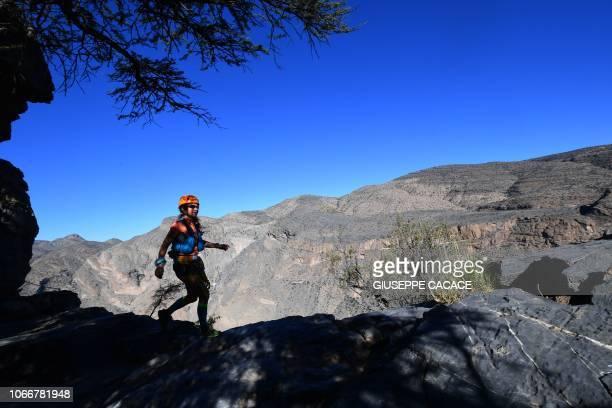 Anna Marie Watson of England runs during the first Oman UltraTrail du MontBlanc 137 km marathon in Nizwa on November 30 2018 Jason Schlarb of US won...