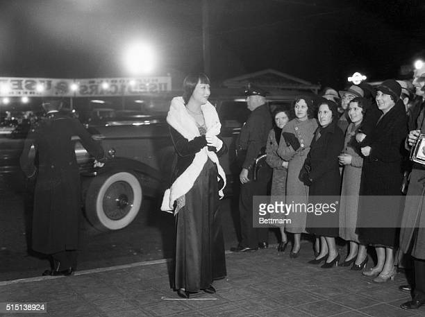 Anna May Wong beautiful Chinese movie star is seen here on her arrival at the Music Box Theater in Hollywood for the premiere of The Old Woman