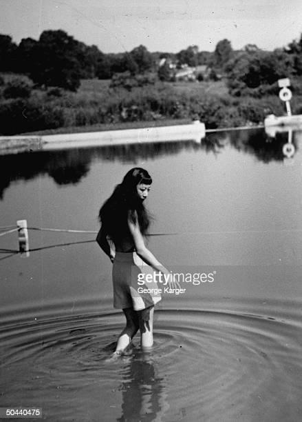 Anna May Wong walking into the lake