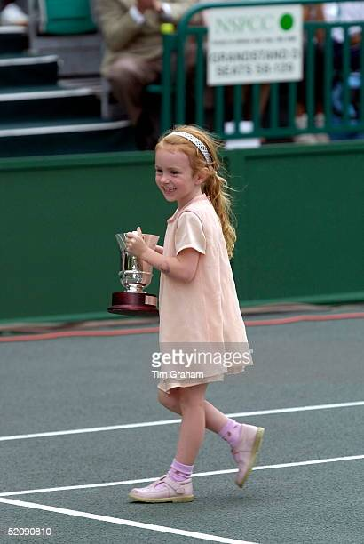 Anna Mcenroe Daughter Of Tennis Star John Mcenroe With His Trophy At A Charity Tennis Tournament On The Tennis Courts At Buckingham Palace In Aid Of...
