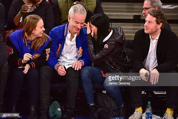 Anna McEnroe John McEnroe Sarah Silverman and guest attend New York Knicks vs Washington Wizards game at Madison Square Garden on December 25 2014 in...