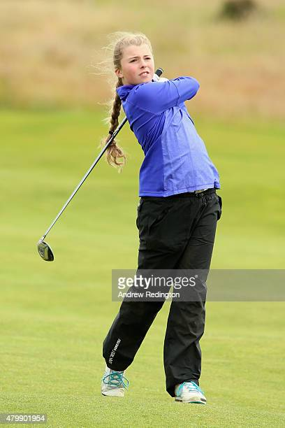 Anna McKay of the ClubGolf initiative hits an approach shot on the second hole during the ProAm prior to the start of the Aberdeen Asset Management...