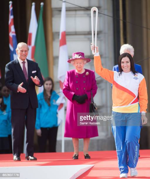 Anna Meares carries the Commonwealth baton as Queen Elizabeth II and Prince Philip Duke of Edinburgh look on during the launch of The Queen's Baton...