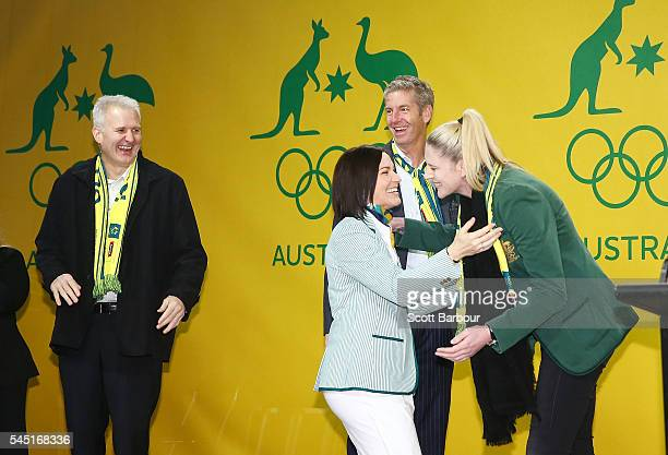 Anna Meares is congratulated by former Australian Olympic flag bearers Andrew Gaze James Tomkins and Lauren Jackson during the Australian Olympic...