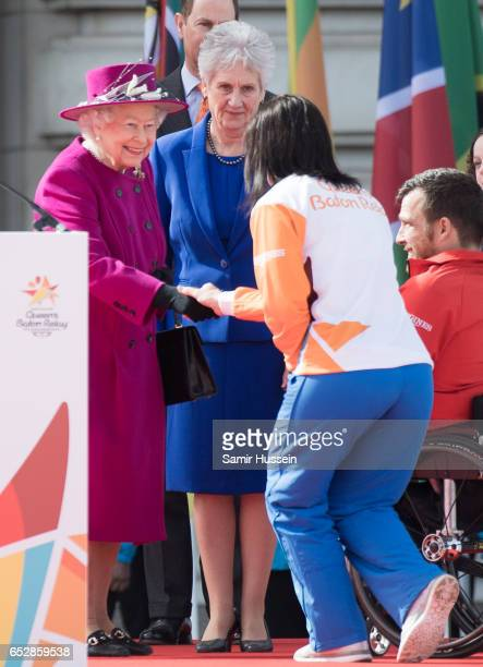 Anna Meares meets Queen Elizabeth II during the launch of The Queen's Baton Relay for the XXI Commonwealth Games being held on the Gold Coast in 2018...