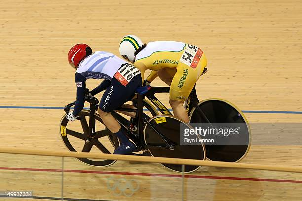 Anna Meares of Australia and Victoria Pendleton of Great Britain cross the line in Race 1 of the Women's Sprint Track Cycling Final on Day 11 of the...