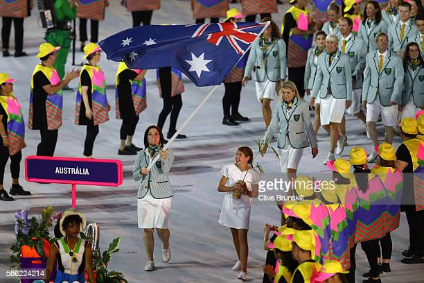 Anna Meares of Australia carries the flag during the Opening Ceremony of the Rio 2016 Olympic Games at Maracana Stadium on August 5, 2016 in Rio de...