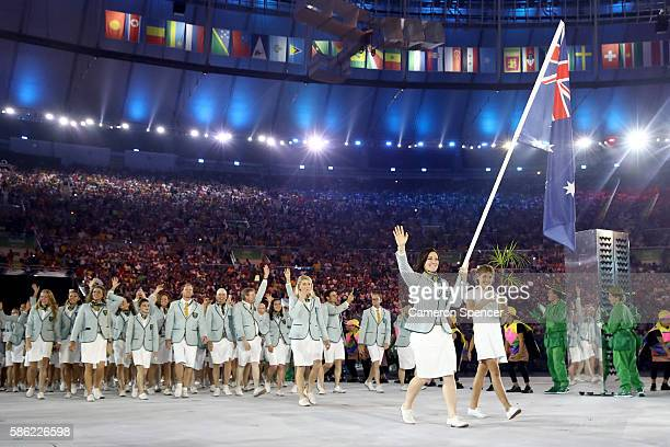 Anna Meares of Australia carries the flag during the Opening Ceremony of the Rio 2016 Olympic Games at Maracana Stadium on August 5 2016 in Rio de...