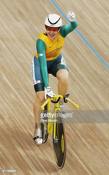 Anna Meares of Australia celebrates after crossing the finish line in a new Olympic and World record time to win the gold medal in the women's track...