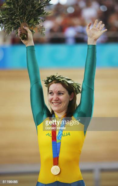 Anna Meares of Australia celebrates after winning the gold medal in the women's track cycling 500 metre time trial final on August 20 2004 during the...
