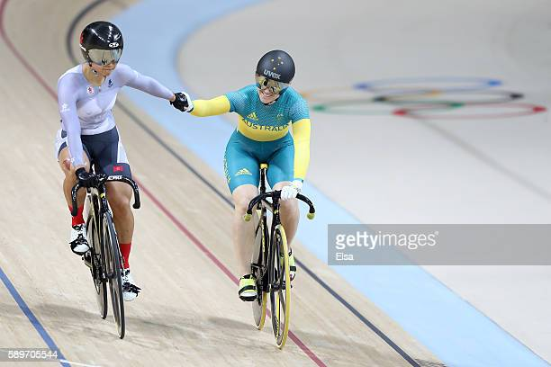 Anna Meares of Australia holds hands with Wai Sze Lee of Hong Kong after the Cycling Track Women's Sprint 1/8 Finals on Day 10 of the Rio 2016...