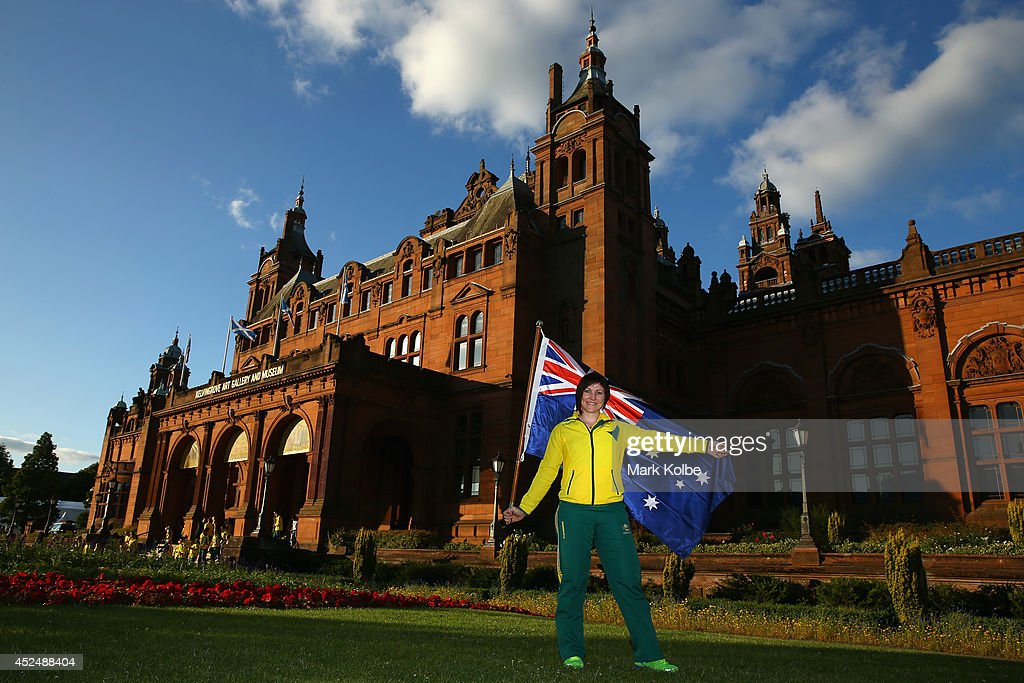 Anna Meares of Australia poses with the Australian flag after she was announced as the flag bearer for the opening ceremony, during the Austrlian Commonwealth Games official team reception at the Kelvin Grove Art Gallery and Museum on July 21, 2014 in Glasgow, Scotland.