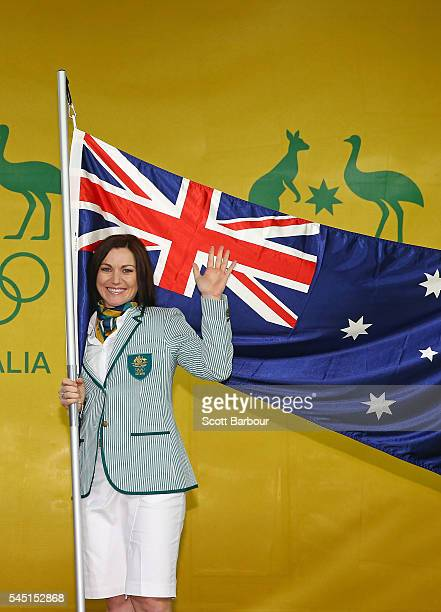 Anna Meares poses with the Australian flag during the Australian Olympic Games flag bearer announcement at Federation Square on July 6 2016 in...