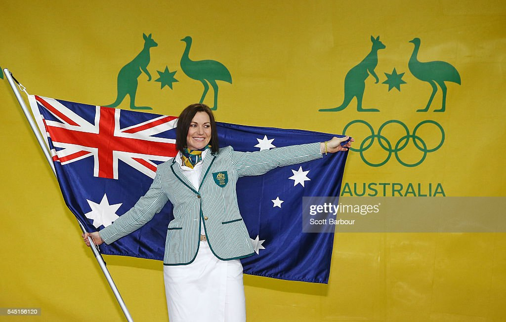 Anna Meares poses with the Australian flag during the Australian Olympic Games flag bearer announcement at Federation Square on July 6, 2016 in Melbourne, Australia.