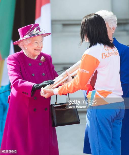 Anna Meares receives the Commonwealth baton from Queen Elizabeth II during the launch of The Queen's Baton Relay for the XXI Commonwealth Games being...