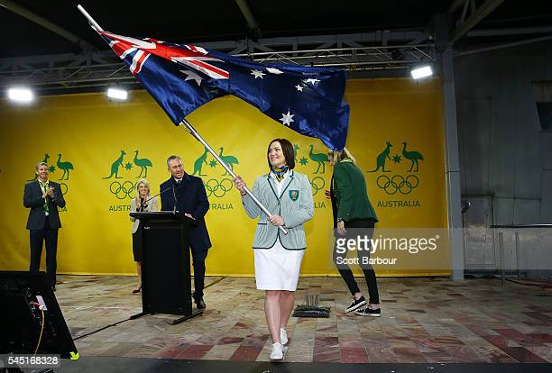 Anna Meares waves the Australian flag during the Australian Olympic Games flag bearer announcement at Federation Square on July 6 2016 in Melbourne...