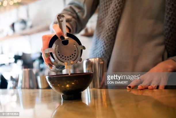 Anna Metelina pours Kava into a bowl to be served at Brooklyn Kava January 18 2018 in New York It's been a mainstay in the South Pacific for...