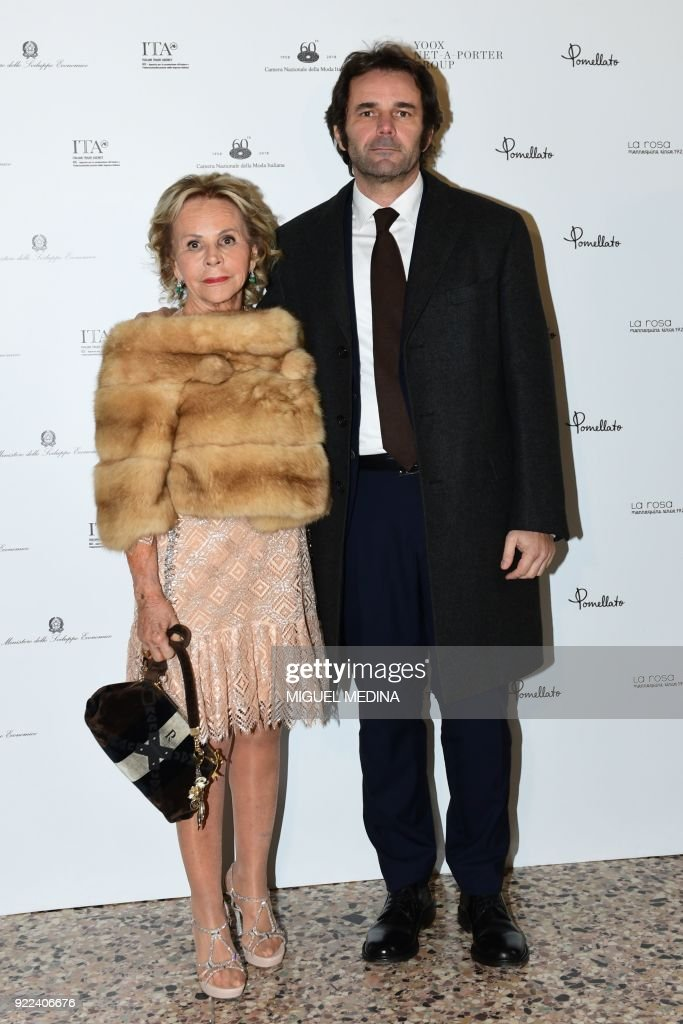 Anna Molinari and Guido Tarabini pose upon the arrival to the exhibition preview of 'Italiana, Italy Through the Lens of Fashion' at Palazzo Reale in Milan, on February 21, 2018. / AFP PHOTO / Miguel MEDINA