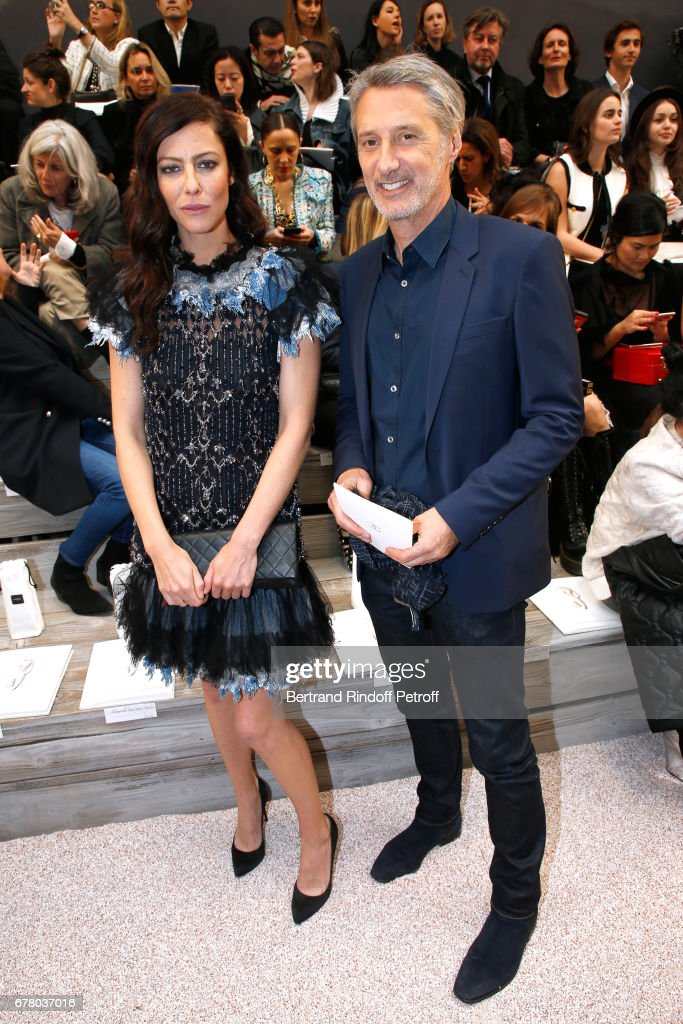 Anna Mouglalis and Antoine de Caunes attend the Chanel Cruise 2017/2018 Collection Show at Grand Palais on May 3, 2017 in Paris, France.