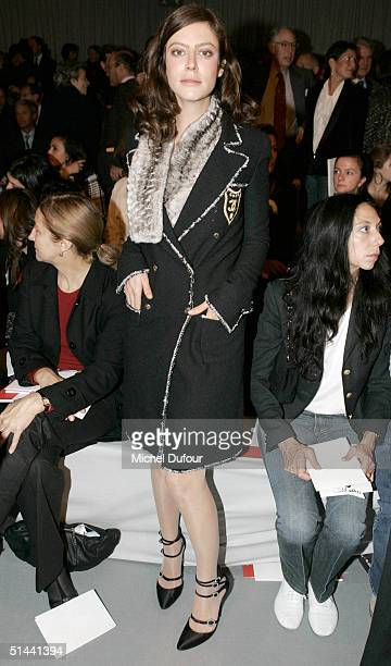 Anna Mouglalis attends the Chanel fashion show as part of Paris Fashion Week Spring/Summer 2005 on October 8 2004 in Paris France