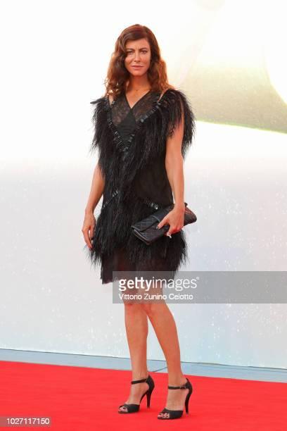 Anna Mouglalis walks the red carpet ahead of the 'L'Annee Derniere a Marienbad' screening during the 75th Venice Film Festival at Sala Giardino on...