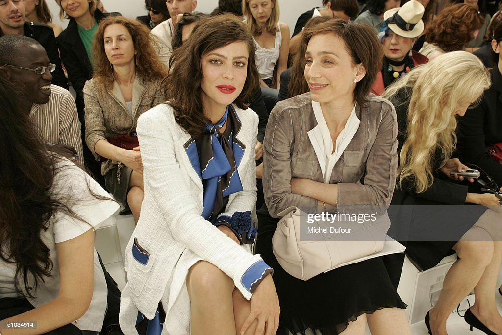 Anna Mouglalis with Kirstin Scott Thomas attend the Chanel Spring/Summer 2005 Fashion Show during Paris Fashion Week on July 7, 2004 in Paris, France.