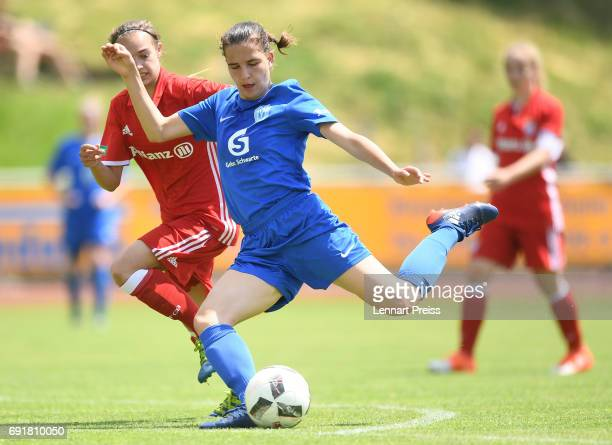 Anna Mueller of FC Bayern Muenchen challenges Jasmin Jabbes of SV Meppen during the B Junior Girl's German Championship Semi Final First Leg match...