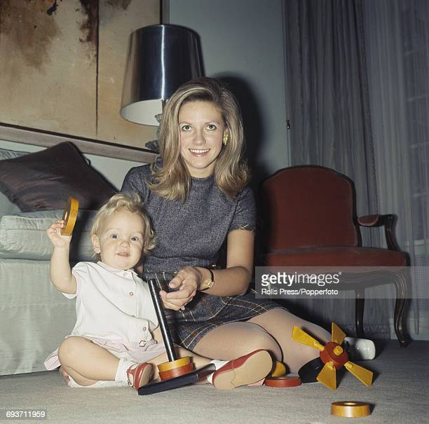 Anna Murdoch wife of Australian newspaper publisher and businessman Rupert Murdoch pictured sitting with her daughter Elisabeth Murdoch at home in...