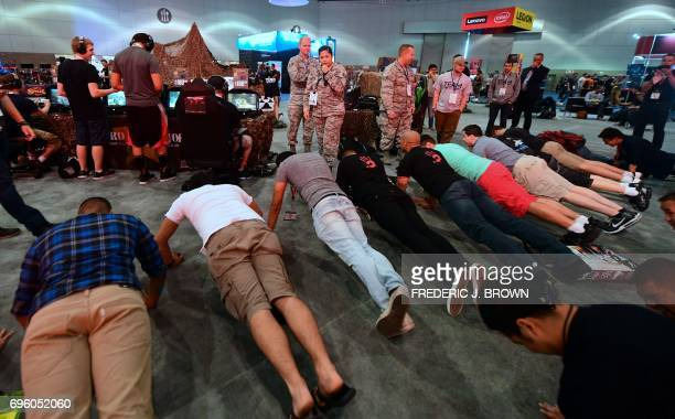 Anna Myers on the microphone and in uniform offers a challenge for push ups in a promotion for the video game 'Call of Duty WWII' on day two of E3...