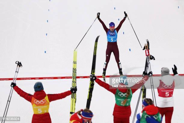 Anna Nechaevskaya of Olympic Athlete from Russia crosses the finish line to be greeted by team mates Anastasia Sedova Yulia Belorukova and Natalia...