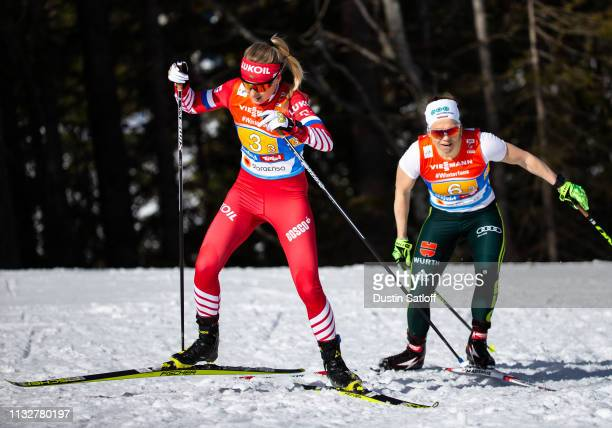 Anna Nechaevskaya of Russia and Sandra Ringwald of Germany compete in the Women's 4x5km Cross Country relay during the FIS Nordic World Ski...