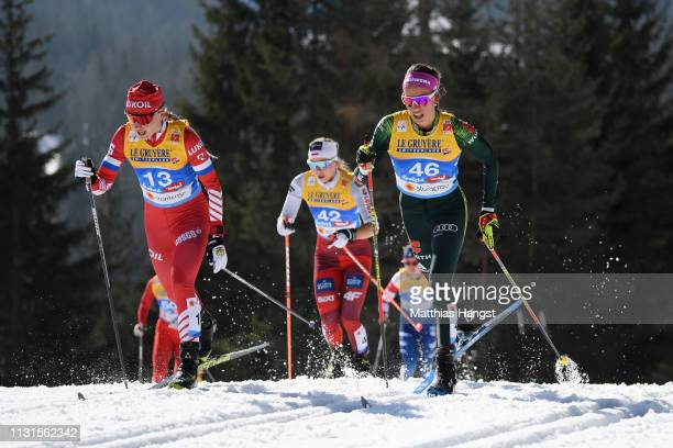 Anna Nechaevskaya of Russia and Sofie Krehl of Germany compete in the Cross Country Skiathlon Ladies 15k race during FIS Nordic World Ski...