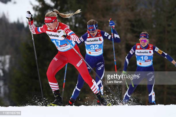 Anna Nechaevskaya of Russia Eveliina Piippo of Finland and Laura Mononen of Finland competes in the Women's Cross Country 30k race during the FIS...