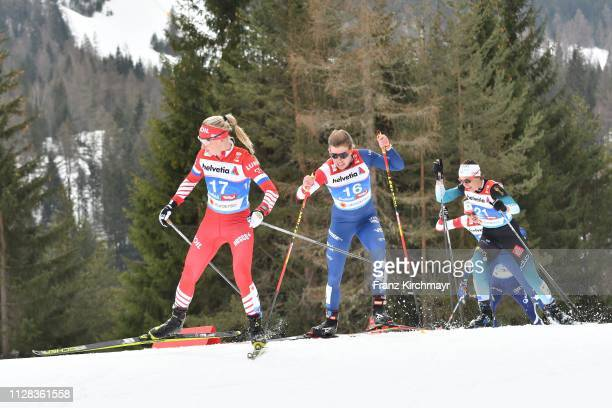 Anna Nechaevskaya of Russia Rosie Brennan of the United States and Anouk Faivre Picon of France during the Women's Cross Country 30km at the FIS...